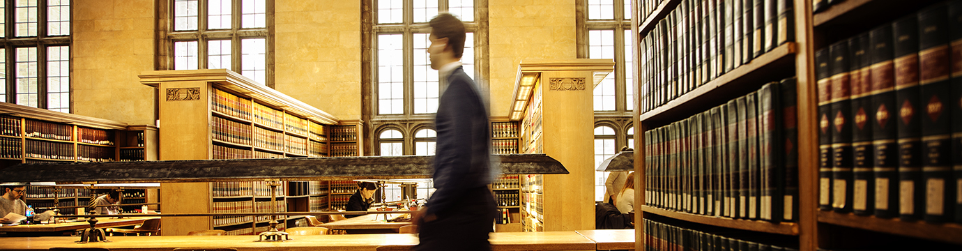 student walking through a library