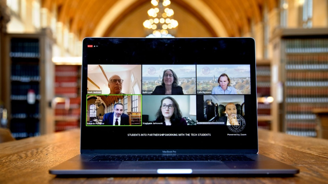 laptop with 6 people on a zoom call