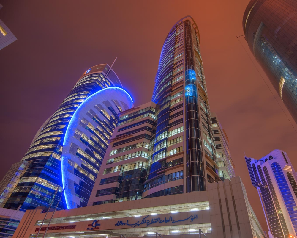Buildings at night in Qatar.