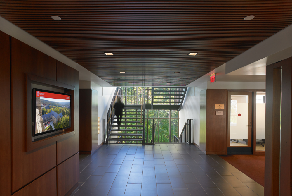 Interior showing an open staircase and wall screens of an academic building