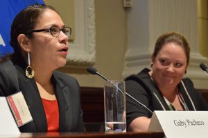 two women speaking at a panelist table