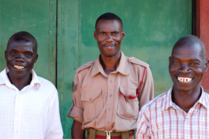 three Malawian men outside a prison