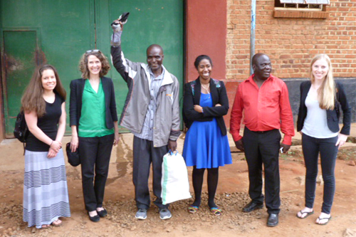 A group of students, faculty and Malawian people outside a prison.