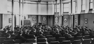 A lecture by Professor Cuthbert W Pound in Boardman Hall, original home of the Law School, circa 1900